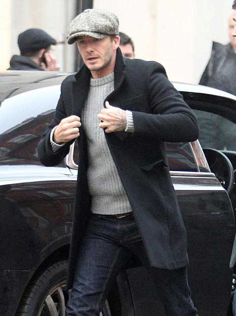 David Beckham has been making a strong case for the flat cap for years, styling it with everything from streamlined basics (left) to country layers. Not only does it look damn stylish in this.