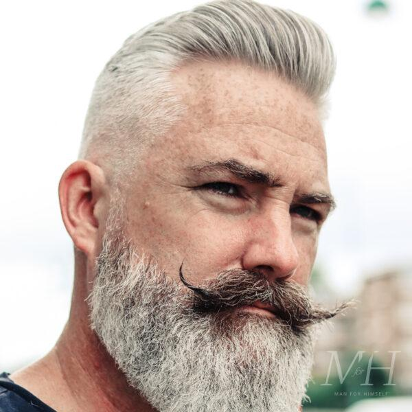 Pompadour With Full Beard and Curly Handlebar Moustache