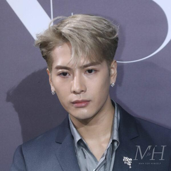 Jackson Wang: Bleached Blonde Side Parted Medium Length Hairstyle
