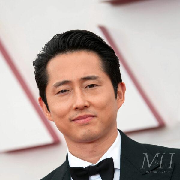 steven yeun medium length hairstyle swept back