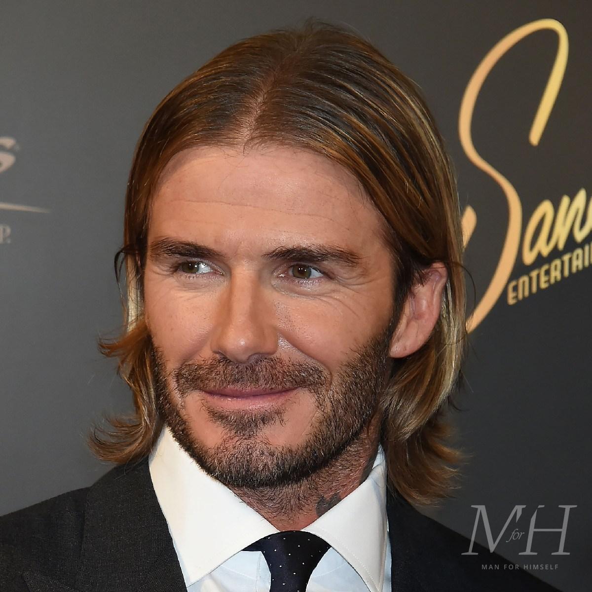 david-beckham-medium-length-hairstyle-1200-GettyImages-857409034